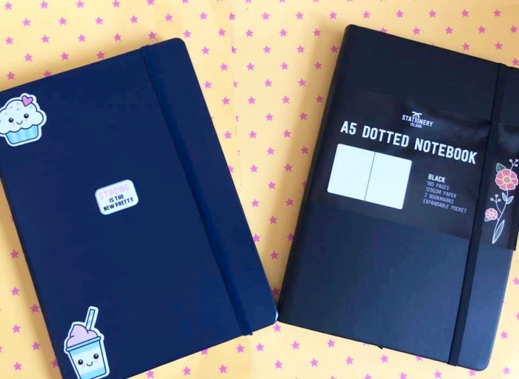 a stationery island bullet journal and navy blue leuchtturm bullet journal with stickers