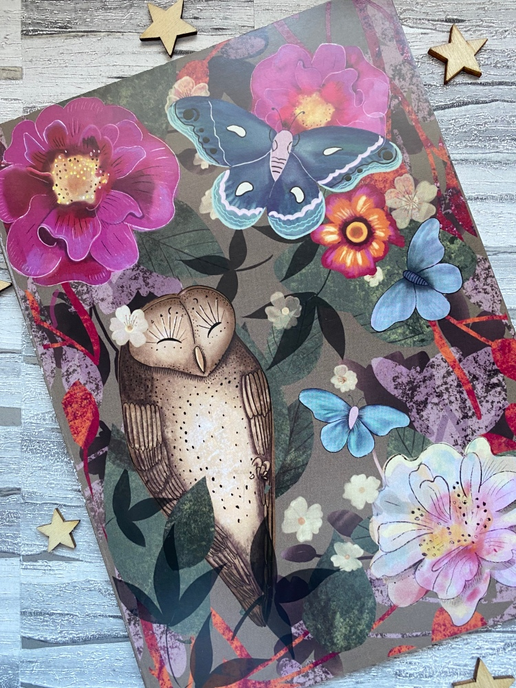 Woodland design on a notebook with an owl and wooden stars