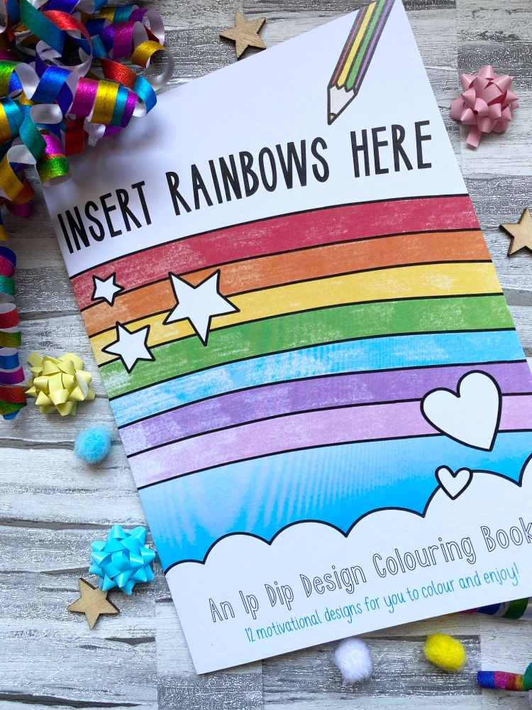colouring book with coloured rainbow, with multicolour confetti and wooden stars