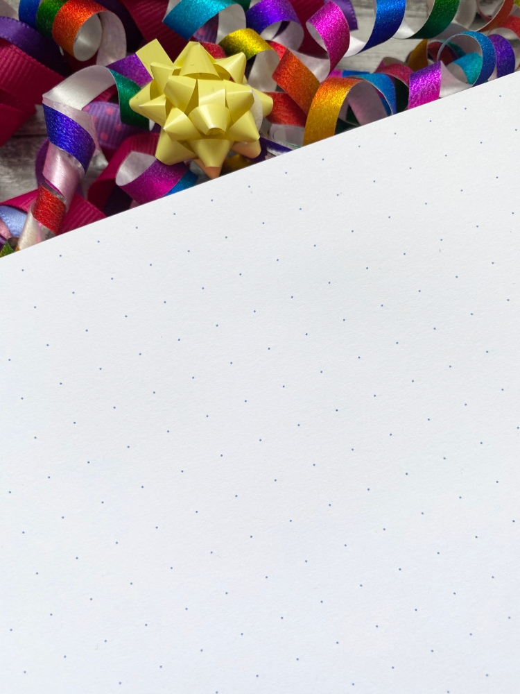 white dotted pages with multicoloured confetti