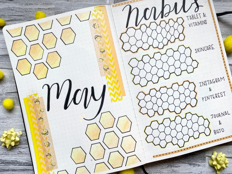 double bullet journal spread, a bee theme with yellow and orange design with bumble bee washi tape
