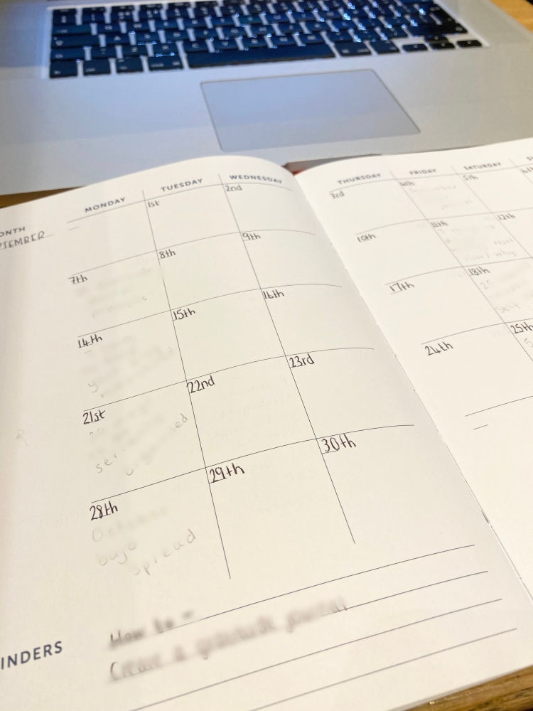 Monthly calendar in a BusyB notebook for