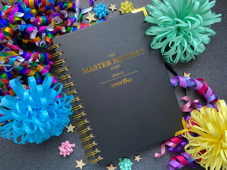 The Master Mindset Diary by Amanthis Stationery with gold foiling and coil bound.