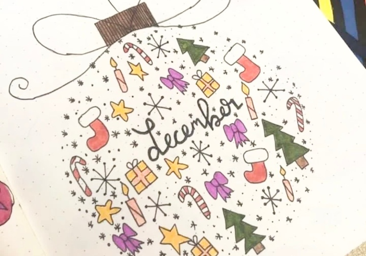December bullet journal front cover page with colourful christmas trees, presents, stockings, stars, candles and stockings.
