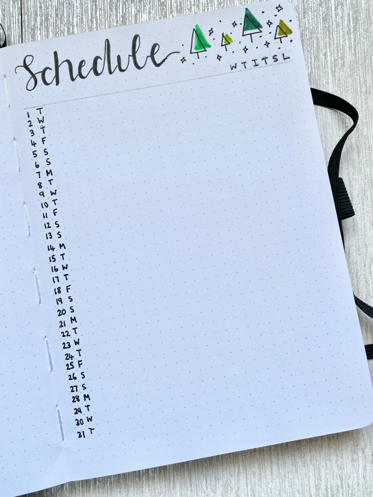 A bullet journal page with a blogging schedule it has a list and tree and star doodles in the right hand corner.