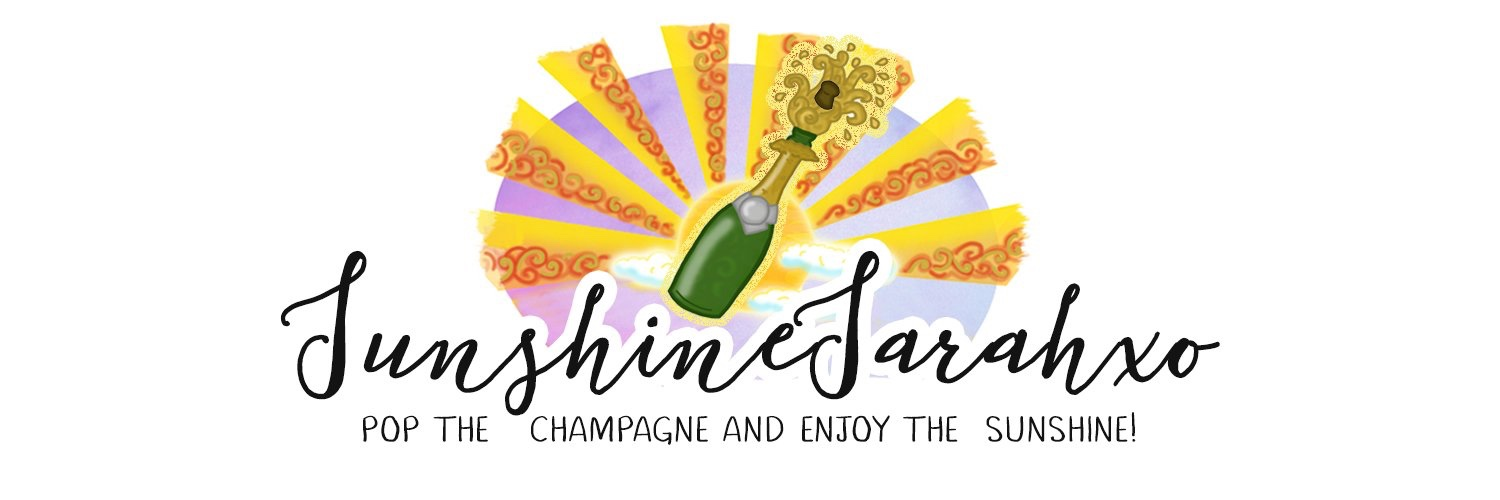 Sunshine Sarah's blog banner with sun and sun rays behind a green bottle of champagne