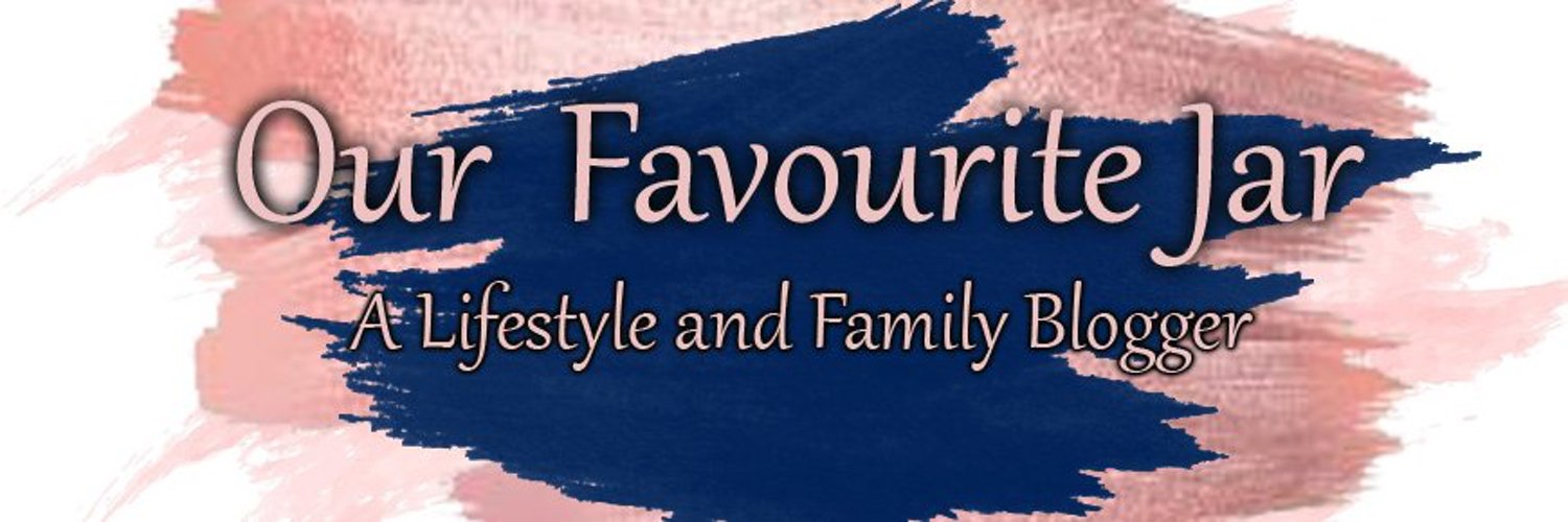 A blog banner that says our favourite jar in rose gold over navy blue paint brush strokes as well as pink brush strokes. The tagline reads a lifestyle and family blogger
