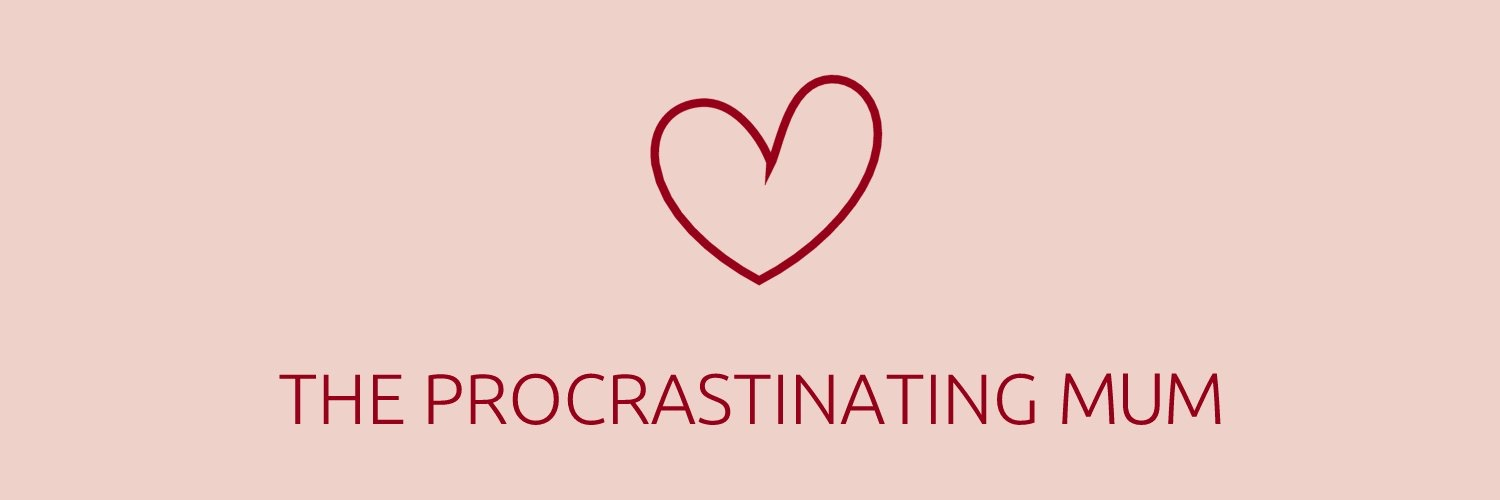 A pink blog banner with a red lined heart above the tagline that is in caps the procrastinating mum also in red ink