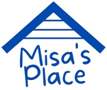 A blog logo with a blue roof and underneath it says Misa's place