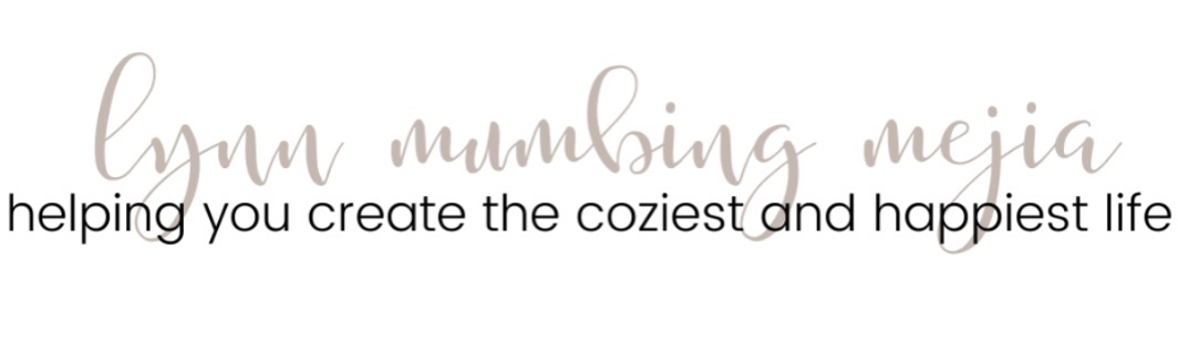 Lynn Mumbing Mejia is in brown cursive writing. With the statement helping you create the cosiest and happiest life.