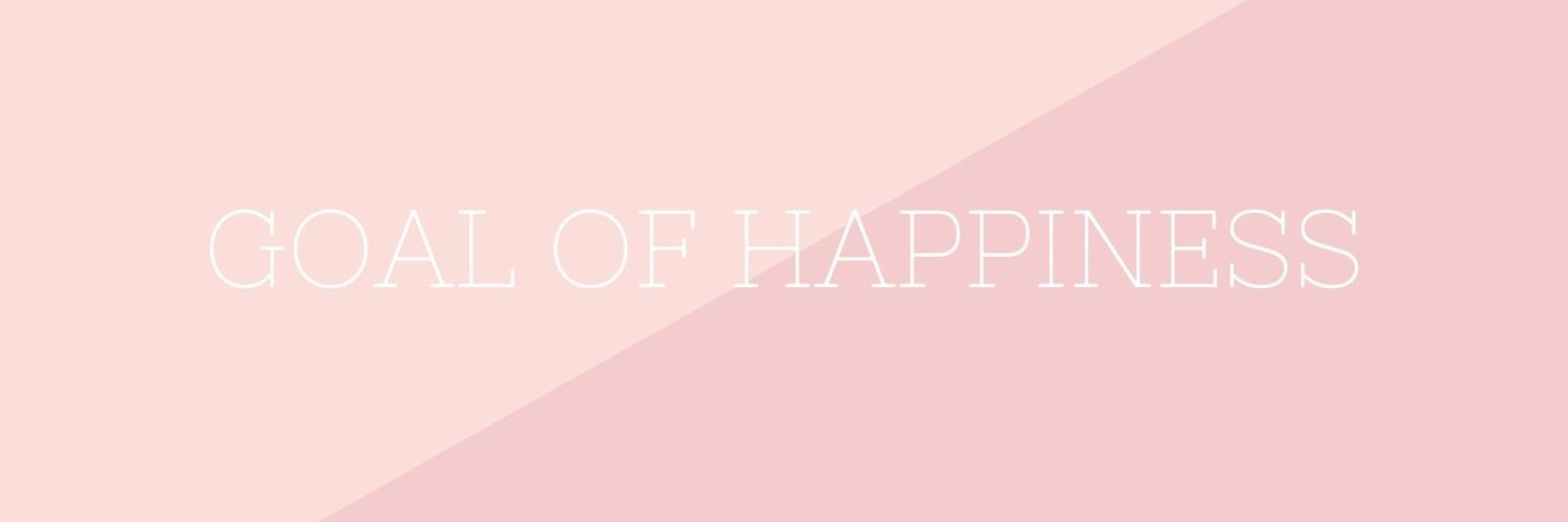 Goal of happiness written in white with a pink background