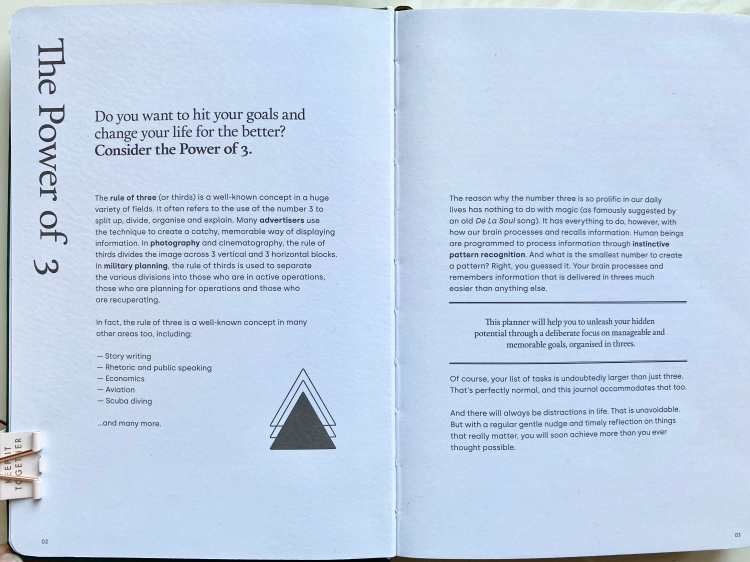 Double page spread in the goal planner explaining what power of three means