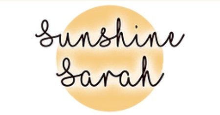 A yellow circle with sunshine Sarah written over the circle in black lettering