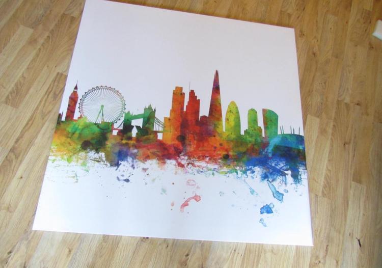 A canvas of London Skyline rainbow print from Photowall on the wooden floor